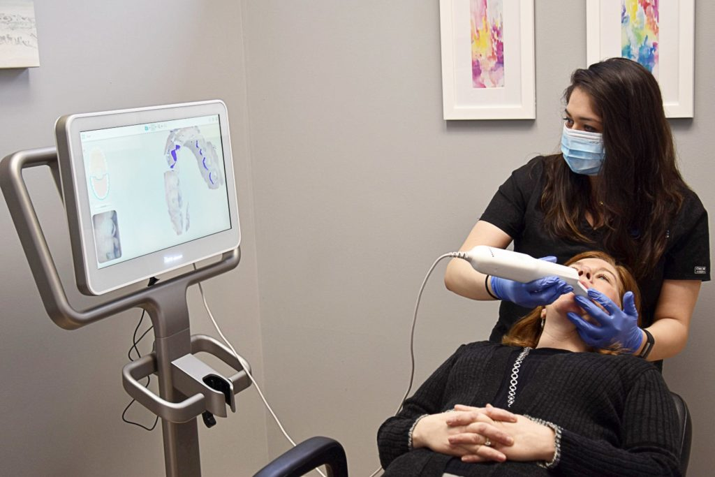 patient getting scanned for Invisalign aligners