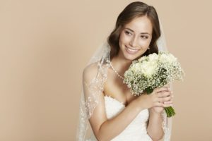 Bride smiling with a bouquet